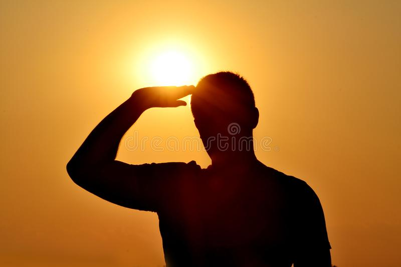 Silhouette of a Soldier Saluting During Sunset stock images