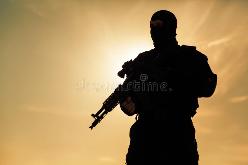 Silhouette of soldier. Silhouette of special forces operators with weapons stock photography