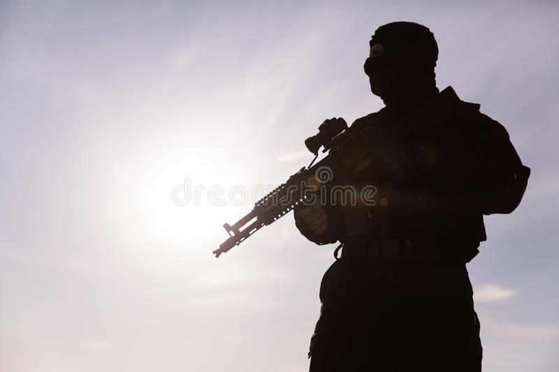 Silhouette of soldier. Silhouette of special forces operators with weapons stock photo