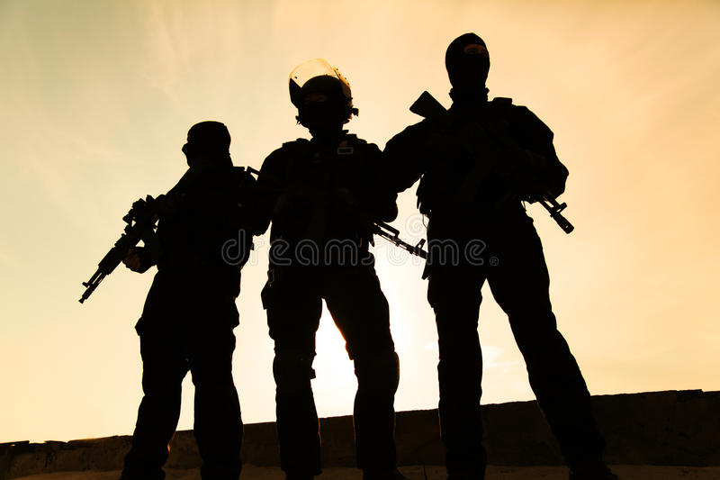 Silhouette of soldier. Silhouette of special forces operators with weapons royalty free stock photography