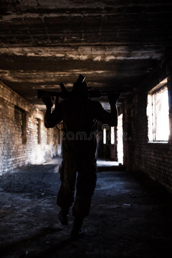 Silhouette of a soldier with weapons at war stock images