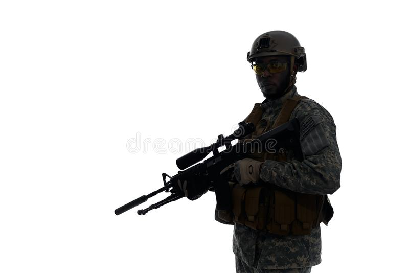 Silhouette of soldier wearing body armour and helmet. royalty free stock photography