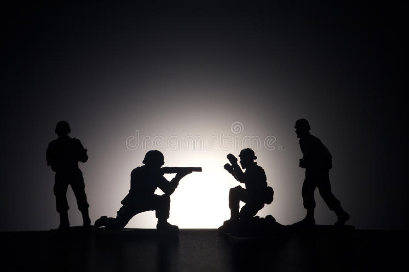 Silhouette of soldiers on a dark background royalty free stock images