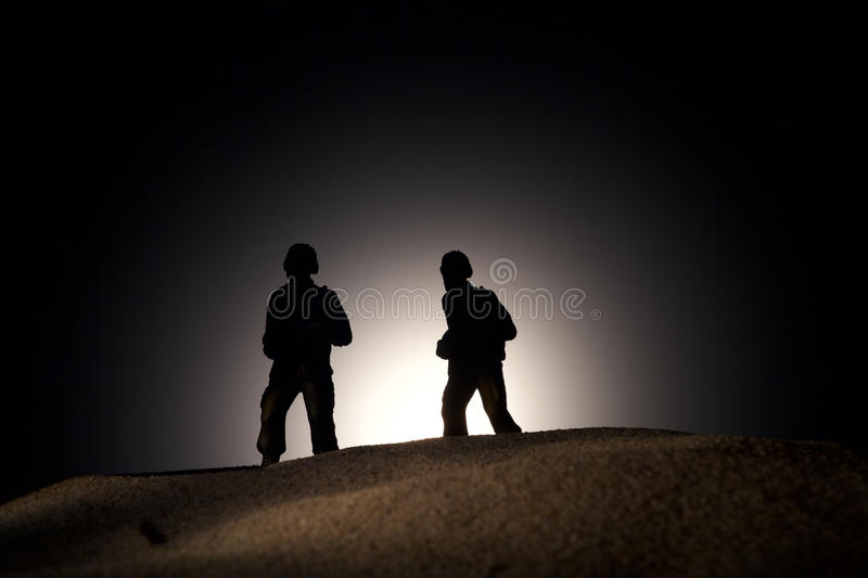 Silhouette of soldiers on a dark background royalty free stock image