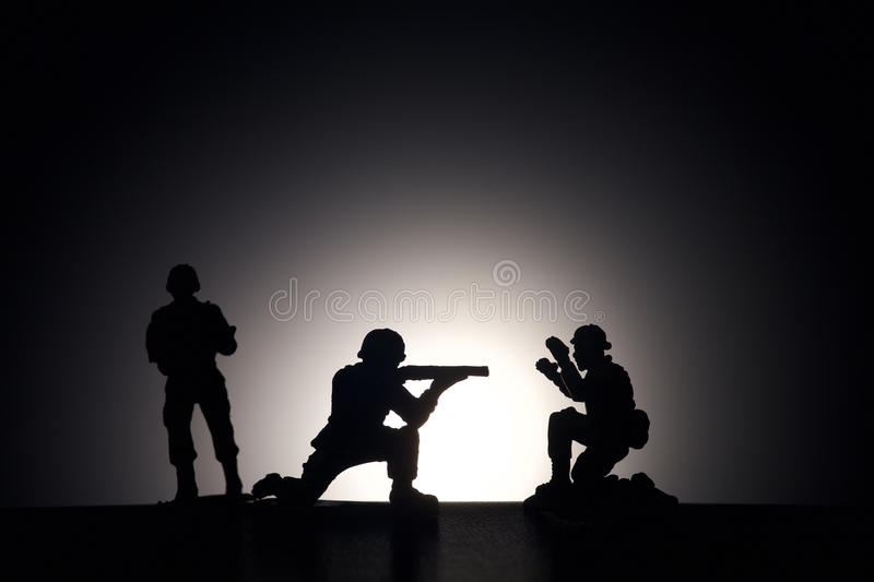 Silhouette of soldiers on a dark background stock photo