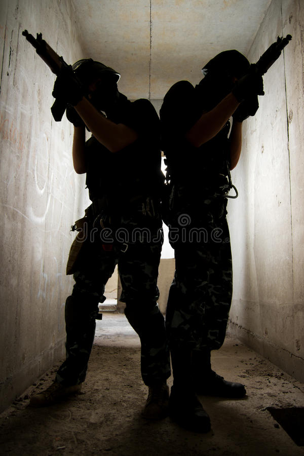 Silhouette of soldiers with guns stock photo