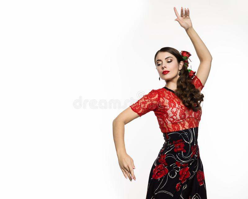Spanish girl flamenco dancer on a light background. free space for your text. Silhouette of spanish girl flamenco dancer on a light background stock photos