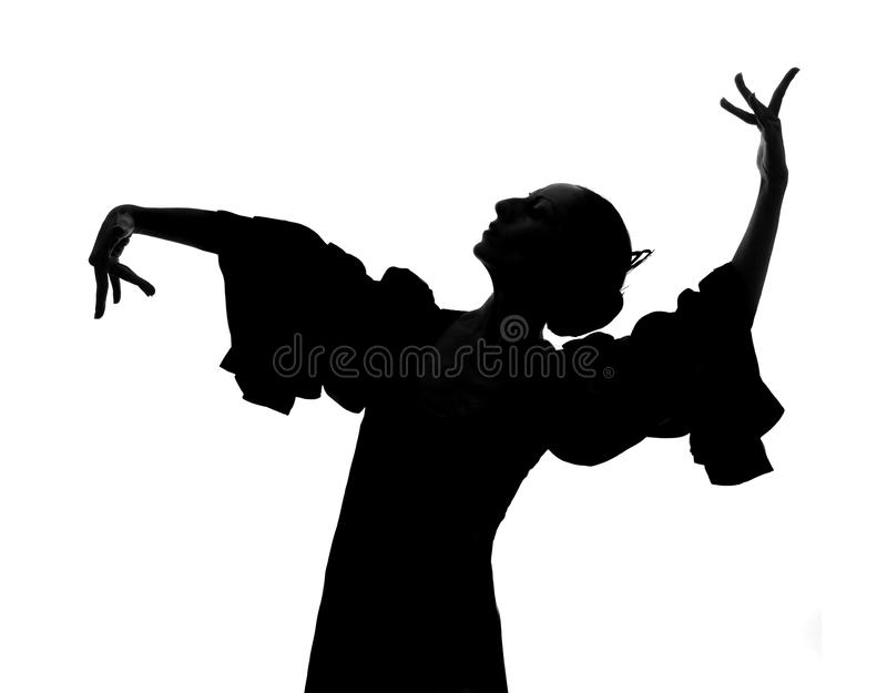 Silhouette of Spanish woman Flamenco dancer dancing Sevillanas. In gypsy dress and comb in traditional Dance of Spain concept performing show isolated on white stock images