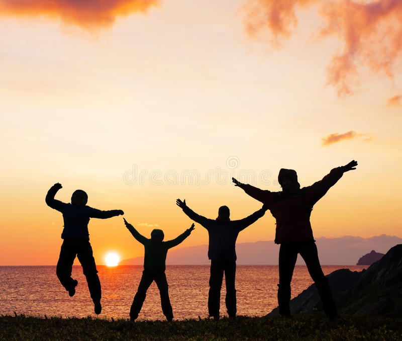 Silhouette of sport friends on beach royalty free stock photo