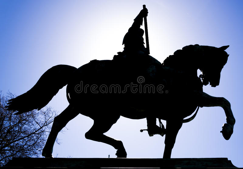 Silhouette of a statue of a knight. In a dutch square royalty free stock photography