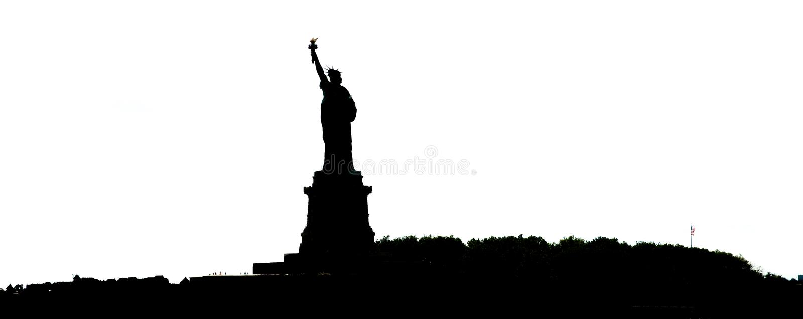 Silhouette of Statue of Liberty in New York City royalty free stock photography