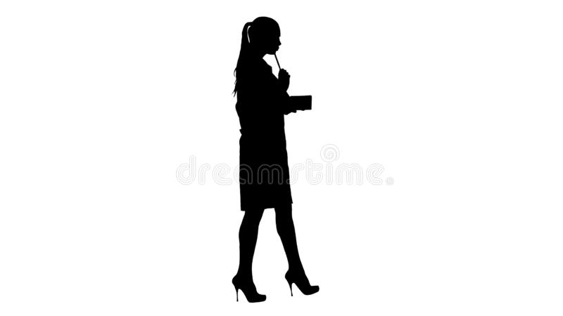 Silhouette Successful medical doctors making notes while walking. stock images