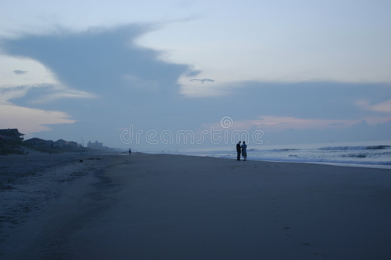 Download Silhouette at sunrise stock image. Image of waves, walk - 15337