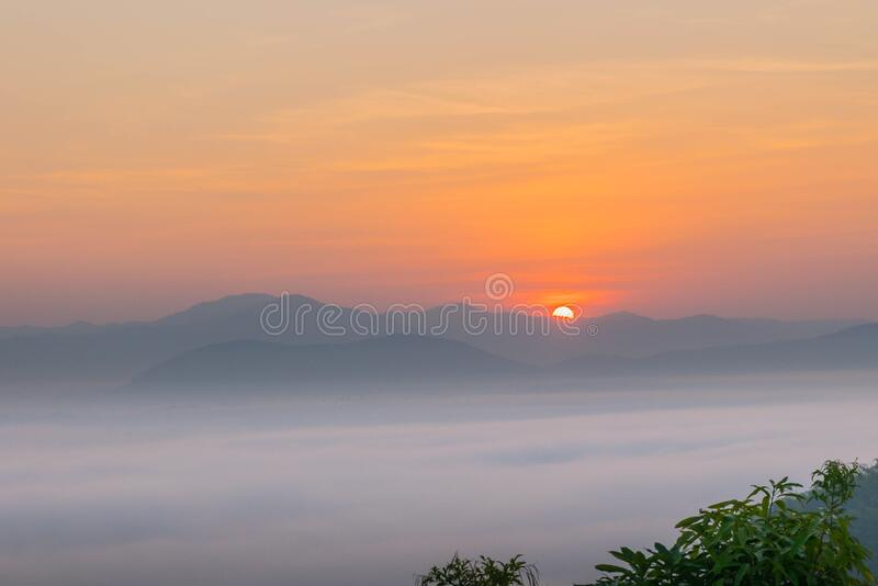 Silhouette the sunrise with  the fog, beautiful sky and cloud at Phu Lam Duan Mountain, Pak Chom District, Loei Province, Thailand royalty free stock images