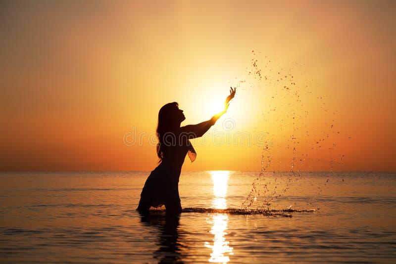 Download Silhouette at sunset stock image. Image of splashing - 24261323