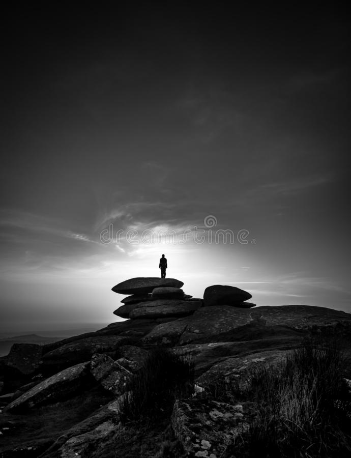 Silhouette at sunset, The Cheesewring, Bodmin Moor, Cornwall royalty free stock images