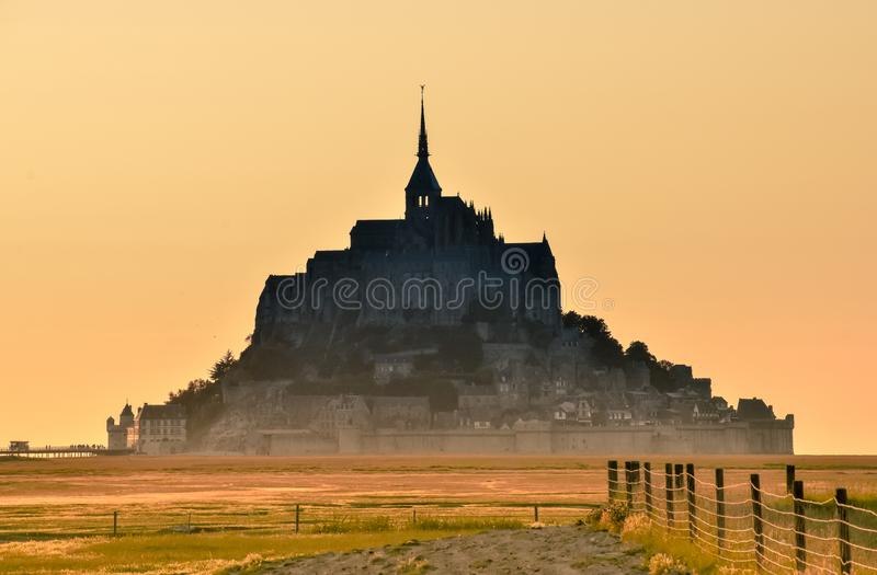 Silhouette at sunset from the farmland of Mont Saint Michel, France. stock images