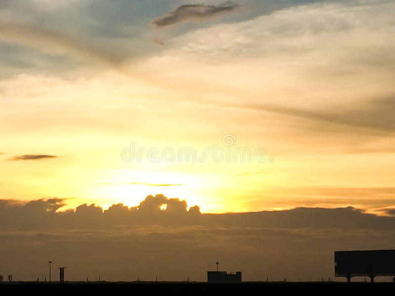 Silhouette of sunset from Hometown in thailand. Downtown royalty free stock image