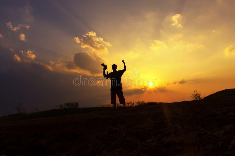 Silhouette sunset photographer shooting photo royalty free stock photos