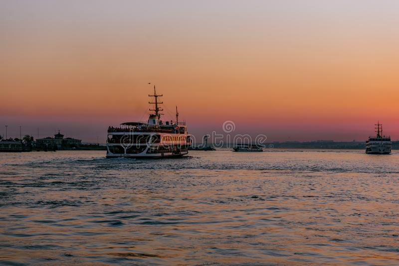 Silhouette sunset view of bosphorous from Kadikoy town stock photography