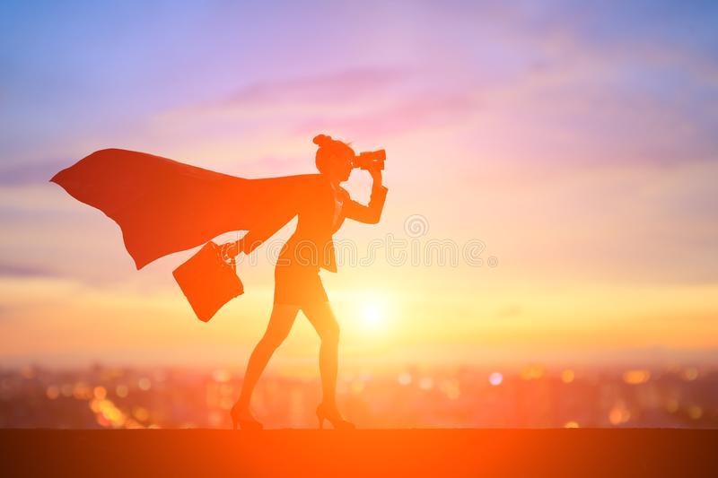 Silhouette of super business woman stock image