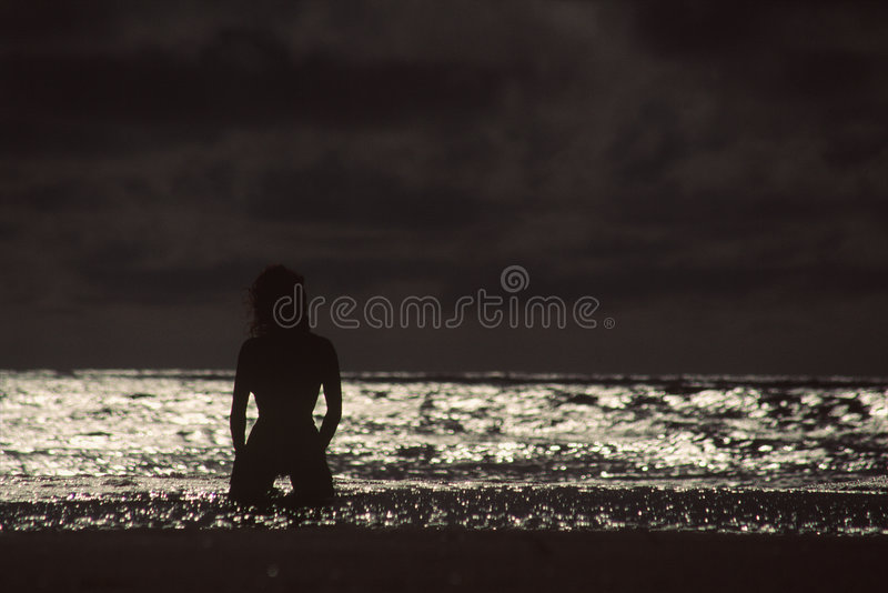 Silhouette of swimmer in water royalty free stock photography
