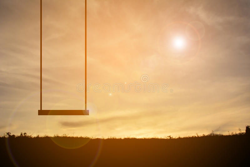 Silhouette of swing at the sky sunset stock image