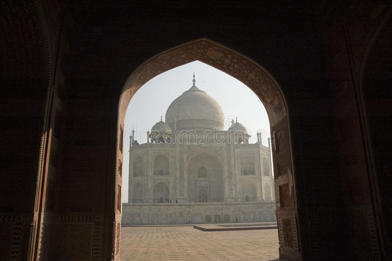 Silhouette of Taj Mahal through an archway. Agra. India. royalty free stock images