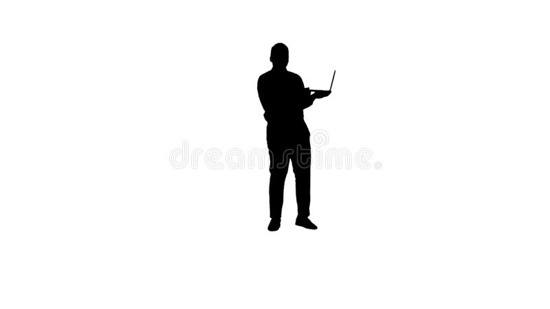 Silhouette Talking to camera young african man with laptop in his hands. stock photo