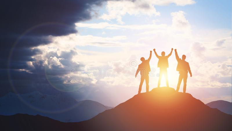 Silhouette of the team on the mountain. stock images