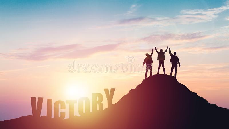 Silhouette of the team on the mountain stock images