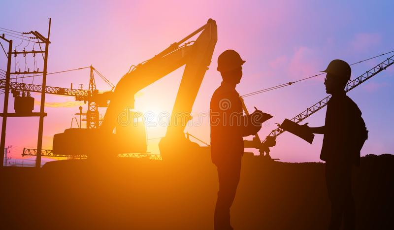 Silhouette Teams engineer looking construction worker. royalty free stock photography