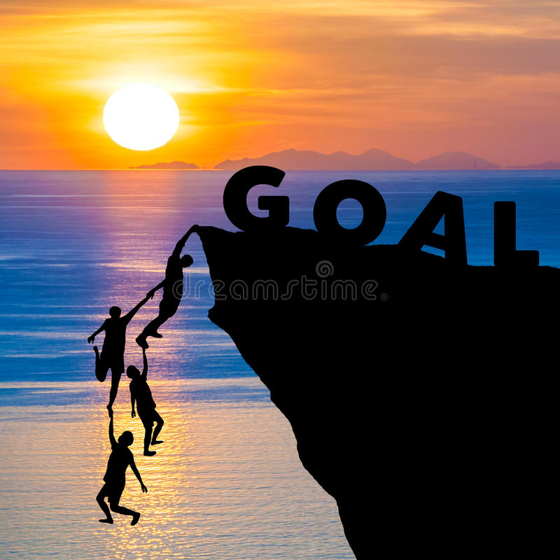 Silhouette teamwork of people climbs into cliff to reach the word GOAL sunrise (goal setting business concept) stock illustration