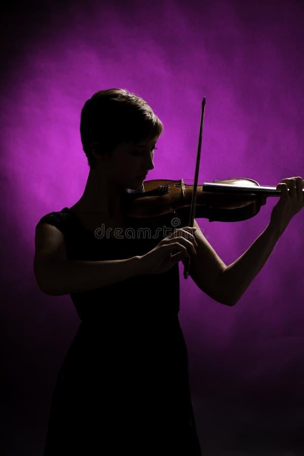 Silhouette Of Teenage Girl Violinist Stock Photos