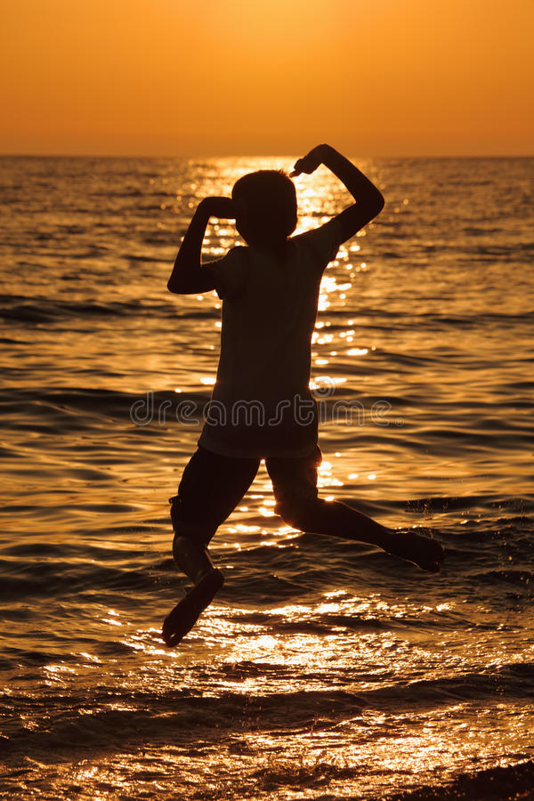 Silhouette teenager. On sea background royalty free stock photography