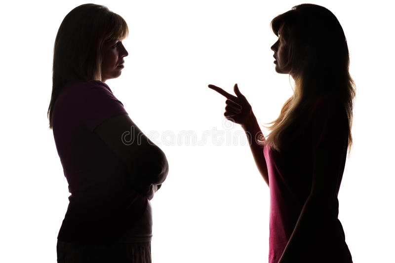 Silhouette teenager blames mother, conflict in family relationships. Silhouette on white isolated background daughters teenager blames mother and pokes a finger royalty free stock images