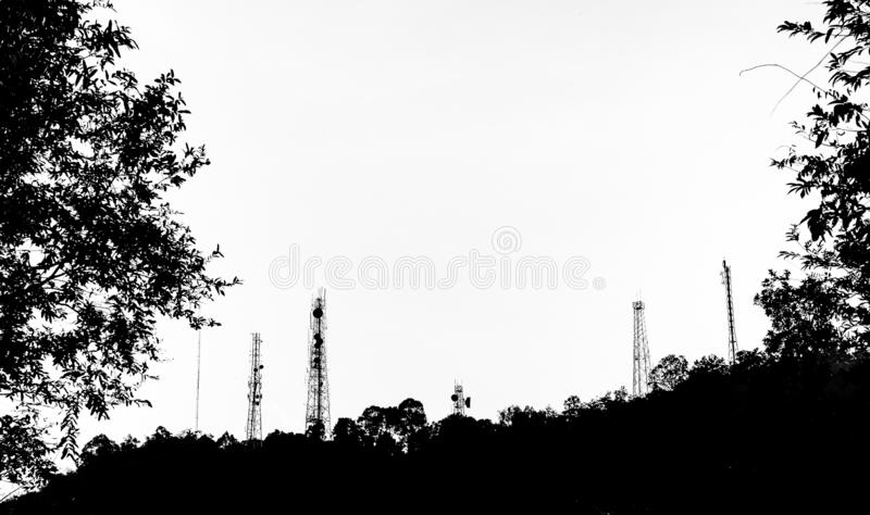 Silhouette of telecom pole at mountain. Black and white style stock photos