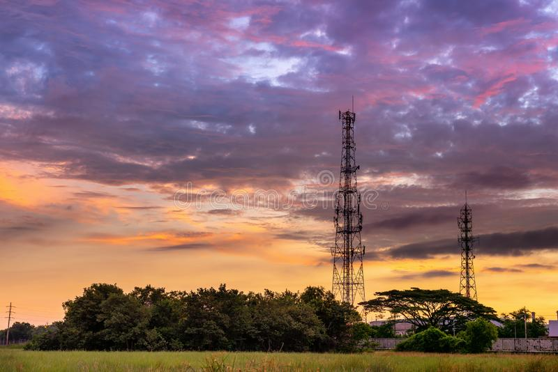Silhouette of Telecommunication and Communication Tower Antenna at Sunrise Cloud Sky., Technology 3G,4G of Industrial Transmission stock image