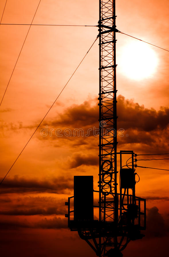 Silhouette telecommunication pole. With sunrise stock photos