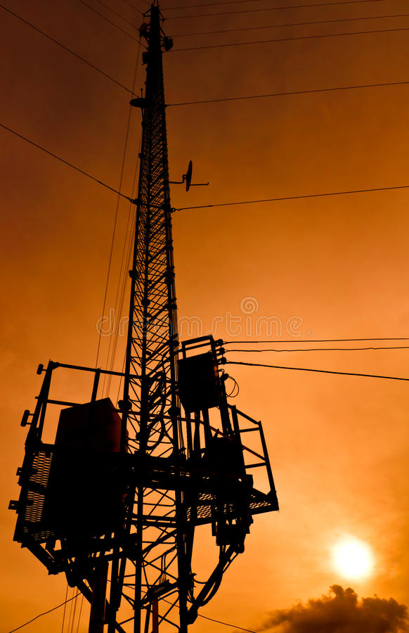 Silhouette telecommunication pole. With sunrise royalty free stock images