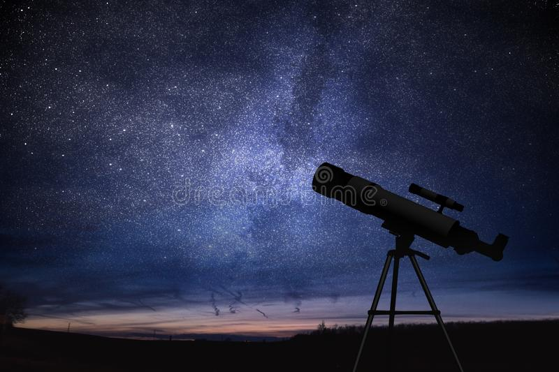 Silhouette of telescope and starry night sky in background. Astronomy and stars observing. Silhouette of telescope and starry night sky in background. Astronomy stock photography