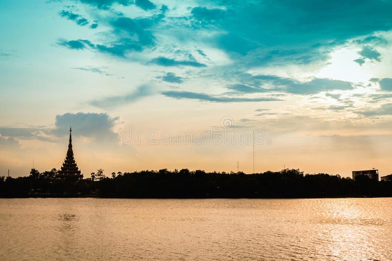 Silhouette temple thai name 'Wat Nong Wang' is located in Khonkaen,Thailand beautiful sky while sunset. Silhouette temple thai name 'Wat Nong Wang or Pramahatat stock photography