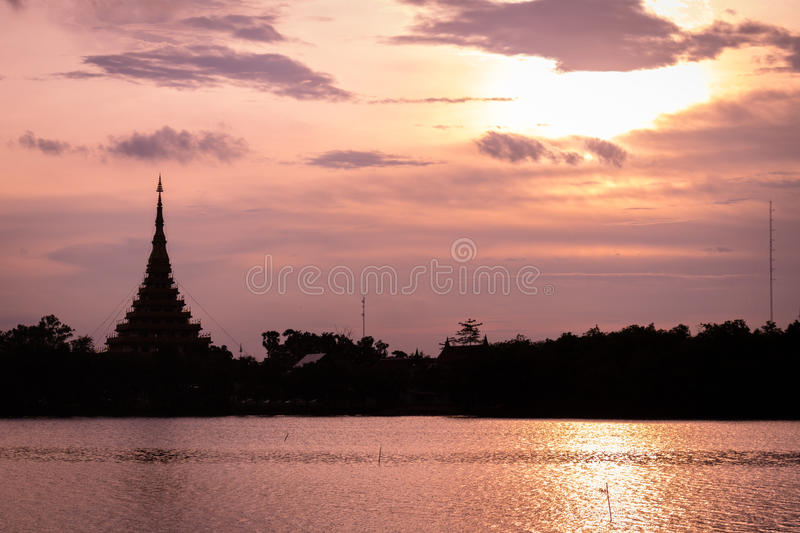 Silhouette temple thai name 'Wat Nong Wang' is located in Khonkaen,Thailand beautiful sky while sunset. Silhouette temple thai name 'Wat Nong Wang or Pramahatat royalty free stock photography