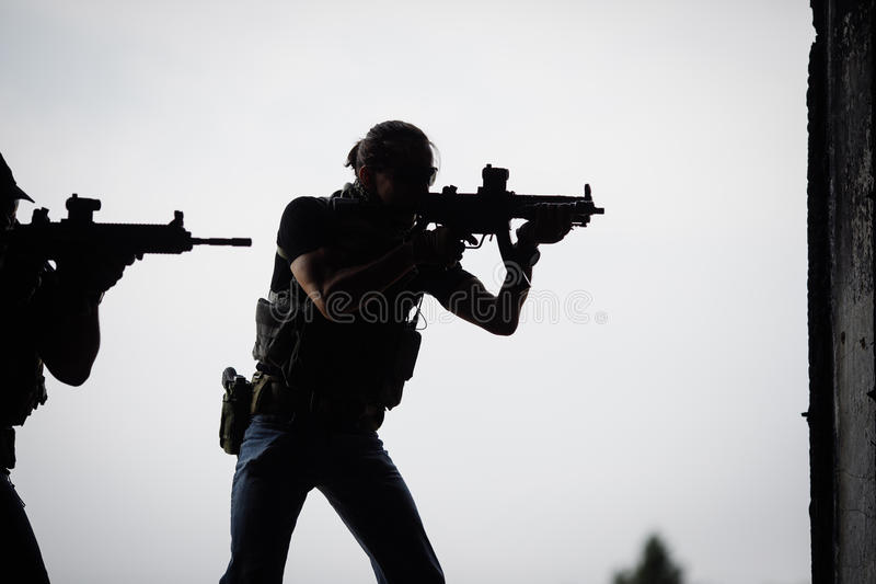 Silhouette of terrorist with assault rifle royalty free stock image