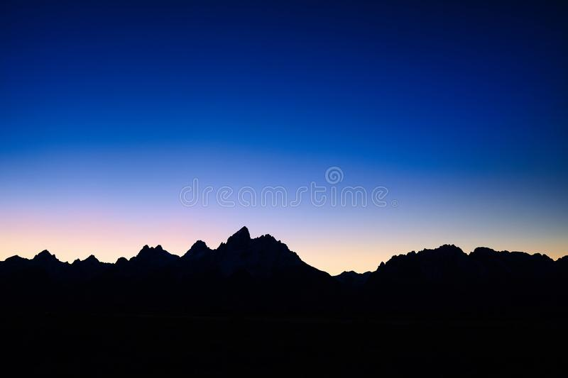 Silhouette of Teton Mountain Range at night, USA. stock images