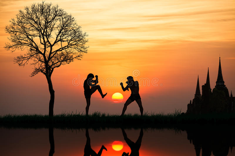Silhouette of a thai's boxing. At sunset royalty free stock image