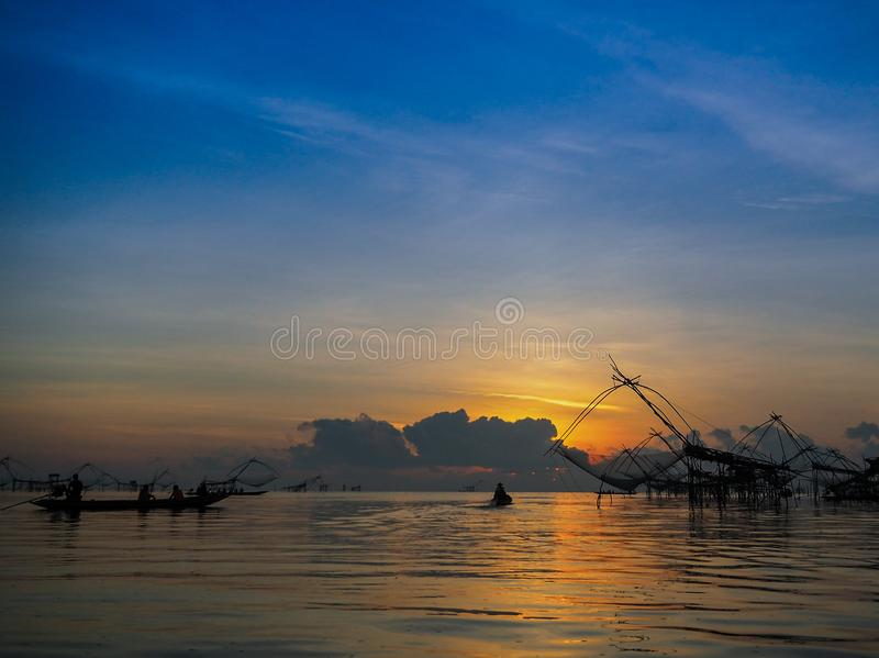 Silhouette thai traditional fishing equipment trap build with ba stock photo