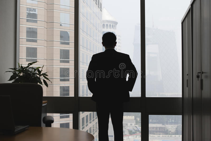 Silhouette of thinking businessman stock image