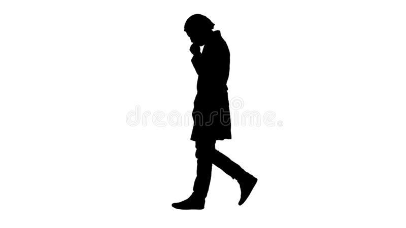 Silhouette Thoughtful male doctor walking. stock images