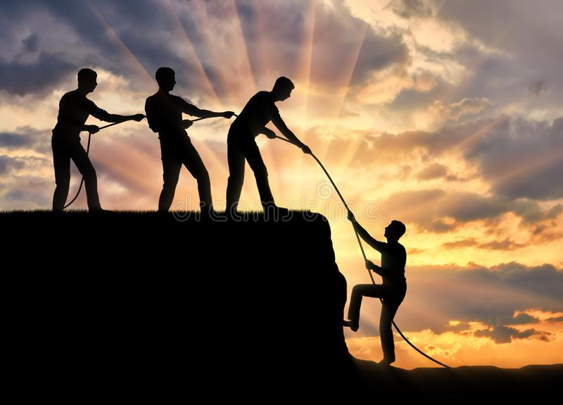 Silhouette of three men help to climb up another man stock image